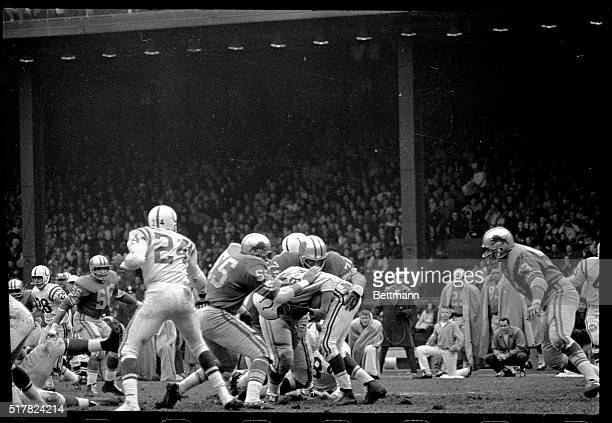 Baltimore Colts quarterback John Unitas watches left end Raymond Berry head out into a pass pattern in the fourth quarter here 11/22 Unitas had a...