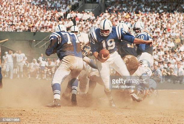 Baltimore Colts quarterback Johnny Unitas runs with the football during a game against the Detroit Lions