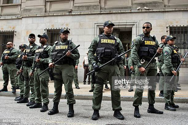 TOPSHOT Baltimore County Sheriffs officers gather after Baltimore Officer Caesar Goodson Jr was acquitted of all charges in his murder trial for the...