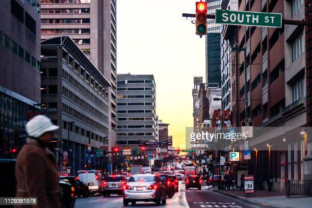 baltimore downtown traffic at sunset time - baltimore maryland stock pictures, royalty-free photos & images