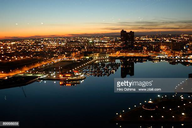 baltimore harbor at dusk - baltimore stock photos and pictures