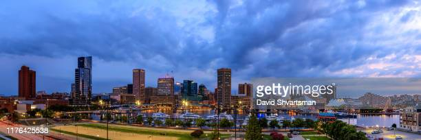 baltimore harbor at the blue hour - baltimore, maryland, usa, september 2019 - national landmark stock pictures, royalty-free photos & images