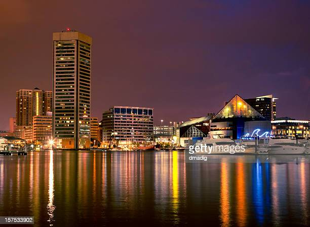 baltimore inner harbor night scene - baltimore stock photos and pictures