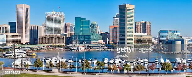 baltimore inner harbor skyline and boats - baltimore stock photos and pictures