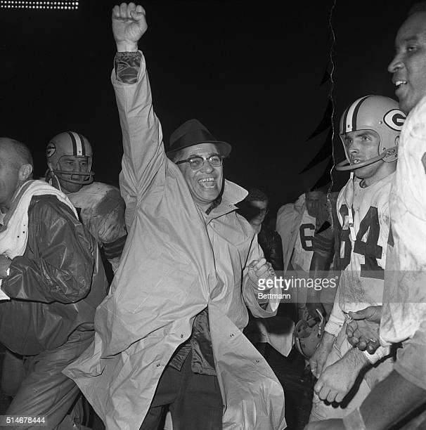 Baltimore, MD: Colts-Packers: Green Bay Packer's Coach Vince Lombardi gives a big victory yell as the final gun sounded in Memorial Stadium in...