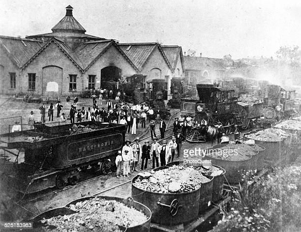 Baltimore Ohio Railroad shops during the Civil War Martinsburg West Virginia 1860s Workmen and bystanders are seen among a group of Camelback...