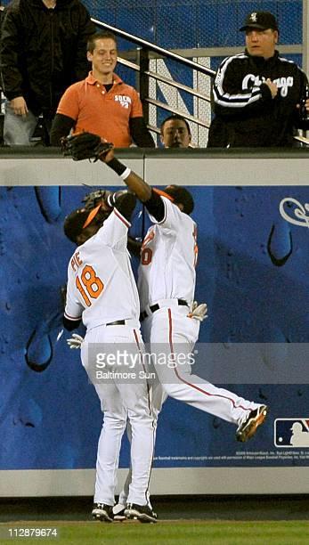 Baltimore Oriole left fielder Felix Pie and center fielder Adam Jones collide after Jones made a running catch on a long fly by Chicago White Sox...