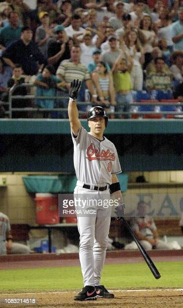 Baltimore Orioles' 3rd baseman Cal Ripken Jr. Acknowledges the Florida crowd before his last at bat during 9th inning action in the Orioles game...