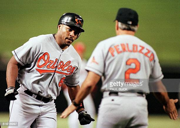 Baltimore Orioles' Albert Belle rounds third and heads home after hitting his 35th homer of the season a solo shot in the seventh inning against the...