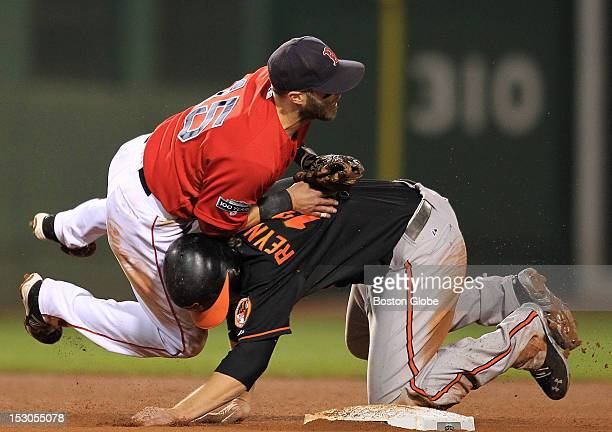 Baltimore Orioles baserunner Mark Reynolds breaks up the double play in the sixth inning as the Boston Red Sox took on the Baltimore Orioles at...