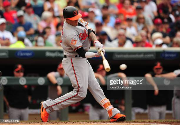 Baltimore Orioles batter Manny Machado hits a single in the second inning of their Major League Baseball game against the Minnesota Twins on July 09...