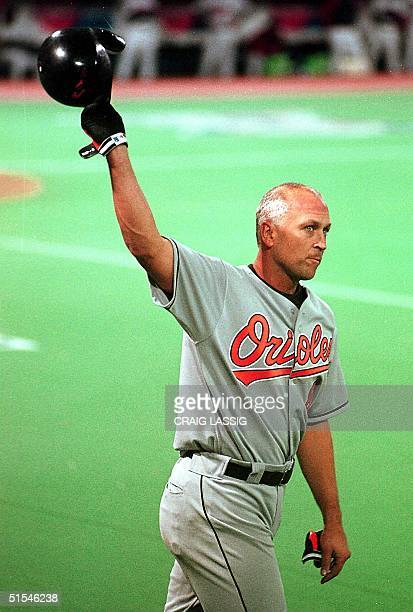 Baltimore Orioles' Cal Ripken, Jr., acknowledges a standing ovation from the crowd after hitting his 3000th career hit in the seventh inning against...