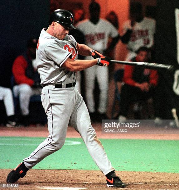 Baltimore Orioles' Cal Ripken, Jr., gets his 3000th career hit in the seventh inning against the Minnesota Twins at the Metrodome 15 April 2000 in...