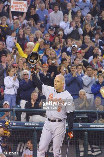 Baltimore Orioles' Cal Ripken, Jr. Tips his cap to the crowd as he acknowledges the applause during second inning of his game against the Seattle...