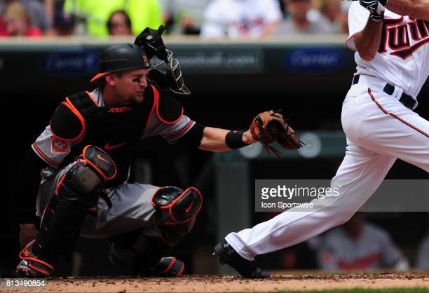 Baltimore Orioles catcher Caleb Joseph loses his catcher's mask from a foul ball hit by Minnesota Twins batter Zack Granite in the second inning of...
