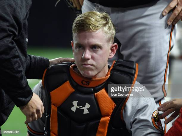 Baltimore Orioles catcher Chance Sisco is looked at by trainers on the field after taking an elbow to the head from third baseman Pedro Alvarez in...