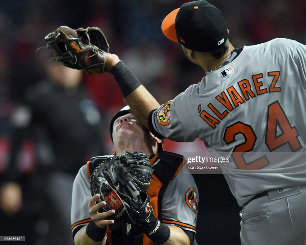 Baltimore Orioles catcher Chance Sisco (15) takes an elbow to the head from third baseman Pedro Alvarez (24) while Alvarez catches a foul ball in the seventh inning of a game against the Los Angeles Angels of Anaheim played on May 1, 2018 at Angel Stadium of Anaheim in Anaheim, CA. Siosco would leave the game after the collision.