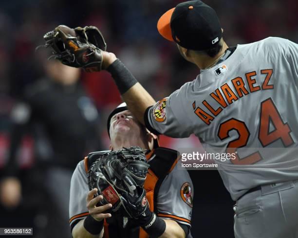 Baltimore Orioles catcher Chance Sisco takes an elbow to the head from third baseman Pedro Alvarez while Alvarez catches a foul ball in the seventh...