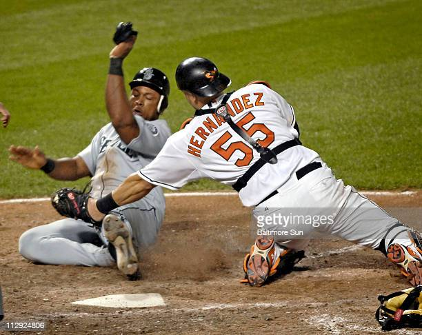 Baltimore Orioles catcher Ramon Hernandez tags out Seattle Mariners' Adrian Beltre as he tried to score on a double in the ninth inning in Baltimore...
