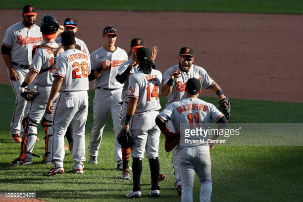Baltimore Orioles celebrate after defeating the Toronto Blue Jays 4-3 in eleven innings at Sahlen Field on August 31, 2020 in Buffalo, New York. The...