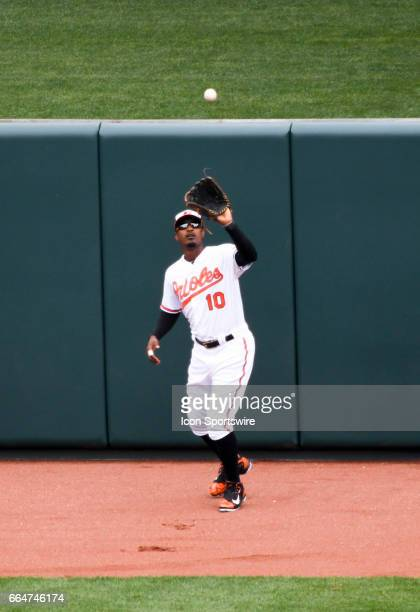 Baltimore Orioles center fielder Adam Jones fields a first inning fly ball against the Toronto Blue Jays on April 3 on Opening Day at Orioles Park at...