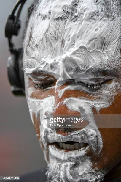 Baltimore Orioles center fielder Adam Jones gets a shaving cream pie after hitting a walk off home run in the the eleventh inning during the Opening...