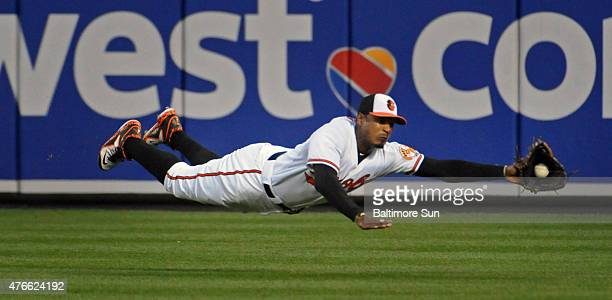 Baltimore Orioles center fielder Adam Jones makes a diving catch to put out the Boston Red Sox's Mookie Betts during the fifth inning on Wednesday,...
