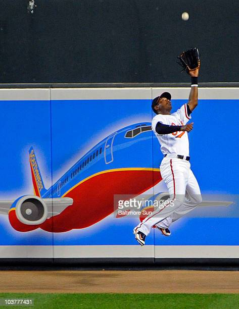 Baltimore Orioles center fielder Adam Jones makes a leaping catch to retire Boston Red Sox's Adrian Beltre in the fourth inning at Camden Yards in...