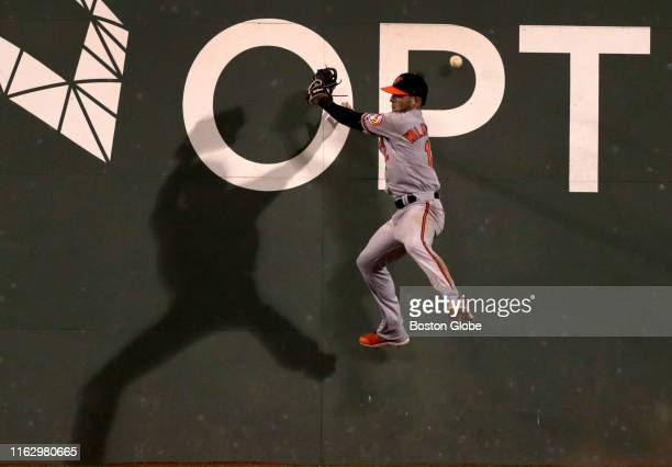 Baltimore Orioles center fielder Stevie Wilkerson leaps unsuccessfully for a deep fly ball by Boston Red Sox center fielder Jackie Bradley Jr that...
