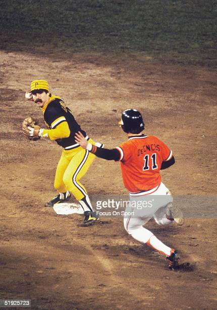 Baltimore Orioles' Doug DeCinces slides into second as Pittsburgh Pirates' second baseman Phil Garner forces an out and prepares to throw to first...