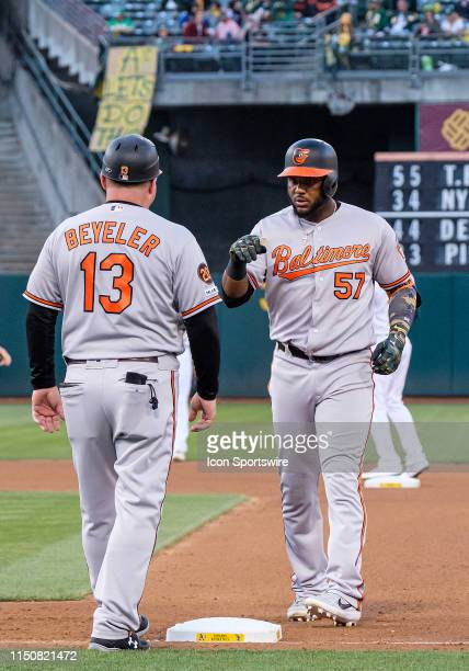 Baltimore Orioles first base coach Arnie Beyeler talks to Baltimore Orioles shortstop Hanser Alberto at first base after his hit during the game...