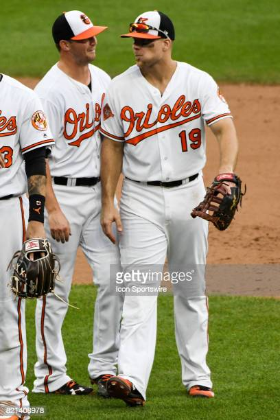 Baltimore Orioles first baseman Chris Davis congratulates relief pitcher Zach Britton following an MLB game between the Houston Astros and the...