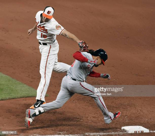 Baltimore Orioles first baseman Chris Davis left tags out Washington Nationals' Anthony Rendon right before he could reach first base as Davis was...