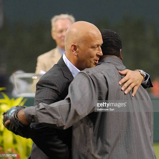 Baltimore Orioles Hall of Fame inductee Cal Ripken Jr shares a moment with Eddie Murray after Murray caught the pregame first pitch at Camden Yards...