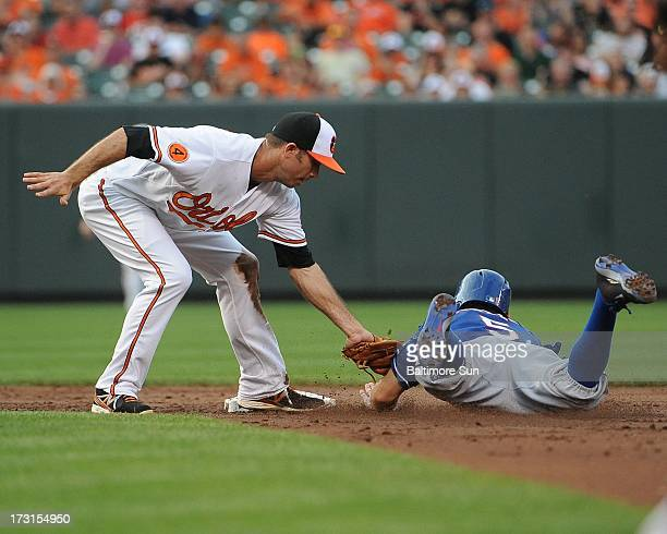 Baltimore Orioles' JJ Hardy tags out Texas Rangers' Ian Kinsler on a stolen base attempt during the 3rd inning at Oriole Park at Camden Yards in...