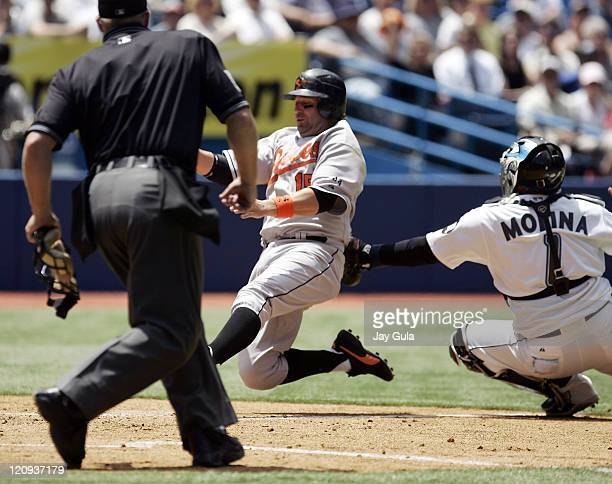 Baltimore Orioles Kevin Milllar is tagged out at home by Toronto Blue Jay C Bengie Molina during today's game at Rogers Centre in Toronto Canada on...