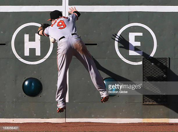 Baltimore Orioles left fielder Nate McLouth can't make a play on a double off the wall by Boston Red Sox left fielder Daniel Nava during the eighth...