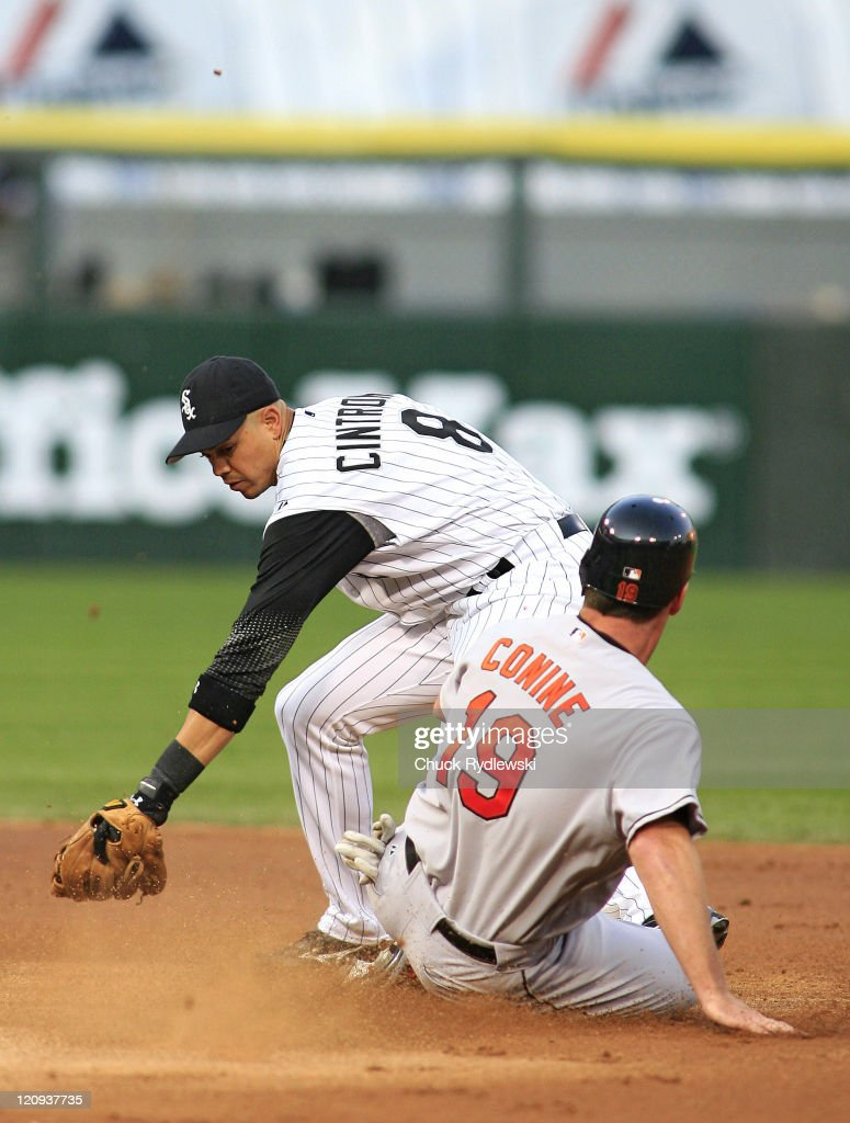 Baltimore Orioles' leftfielder, Jeff Conine, steals second Base as Alex Cintron takes the late throw during the game against the Chicago White Sox July 6, 2006 at U.S. Cellular Field in Chicago, Illinois. The Orioles trailed the White Sox 7-4 in the 6th inning.