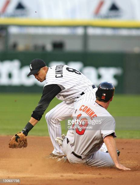 Baltimore Orioles' leftfielder Jeff Conine steals second Base as Alex Cintron takes the late throw during the game against the Chicago White Sox July...