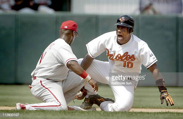 Baltimore Orioles' Miguel Tejada right reacts in pain as he jammed his right ankle while sliding into second base to avoid the tag by Philadelphia...