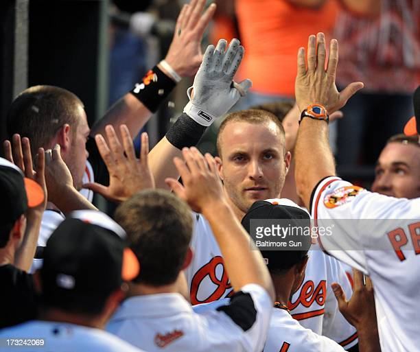 Baltimore Orioles' Nolan Reimold is congratulated after his 3run homer in the 4th inning against the Texas Rangers at Oriole Park at Camden Yards in...