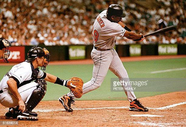 Baltimore Orioles outfielder Joe Carter hits a home run 10 May in the sixth inning to tie the score 33 during their game with the Tampa Bay Devil...