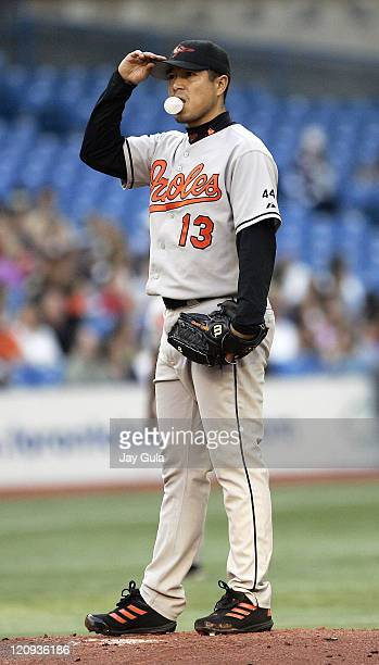 Baltimore Orioles P Rodrigo Lopez blows a bubble and adjusts his cap after surrendering 3 runs in the 1st inning during tonight's game vs the Toronto...