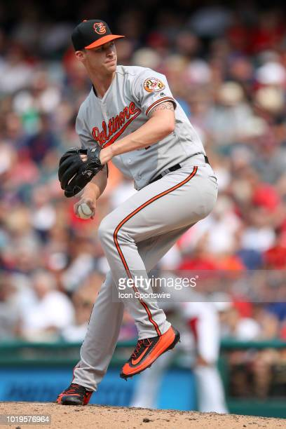 Baltimore Orioles pitcher Cody Carroll delivers a pitch to the plate during the seventh inning of the Major League Baseball game between the...