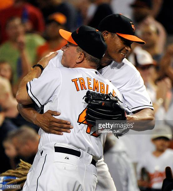 Baltimore Orioles pitcher Daniel Cabrera gets a hug from manager Dave Trembley after pitching a complete game, 5-2 win against the Kansas City Royals...