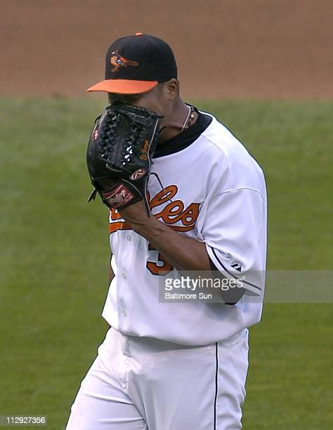 Baltimore Orioles pitcher Daniel Cabrera shouts into his glove after giving up a fourth inning home run to Texas Rangers Ramon Vazquez during game...