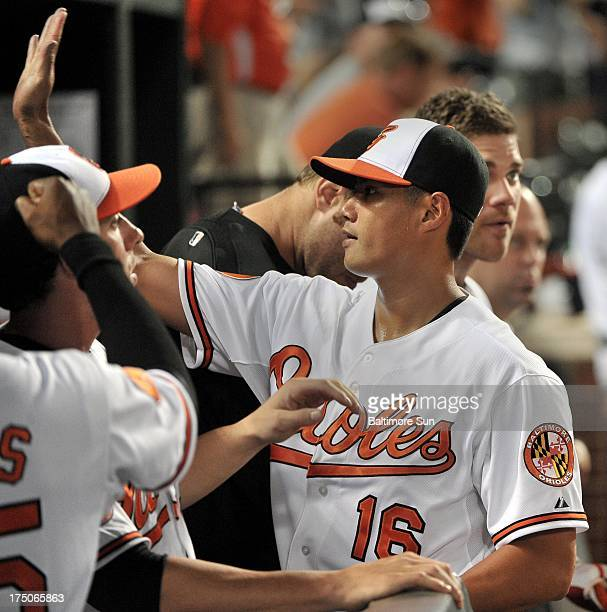Baltimore Orioles pitcher WeiYin Chen is congratulated in the dugout during an MLB game against the Houston Astros at Oriole Park at Camden Yards in...