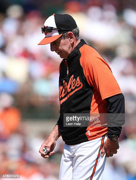 Baltimore Orioles pitching coach Dave Wallace walks back to the dugout after talking with pitcher Alfredo Aceves during the eighth inning of the game...