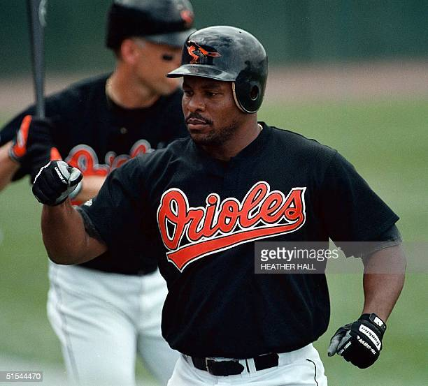 Baltimore Orioles' player Albert Belle is greeted by teammates after hitting a homerun in the second inning against the Minnesota Twins 18 March 2000...