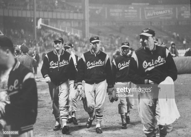 Baltimore Orioles players leaving the field
